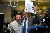 Antioco Carrillo and Theo Small are the first in Clark County to receive a same-sex marriage certificate at the Marriage License Bureau on Thursday, Oct. 9, 2014.