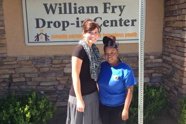 Nevada Partnership for Homeless Youth case manager Shawna Freimanis, left, stands with Brianna Grandberry, 18, outside the group's Drop-in Center on Wednesday, Oct. 8, 2014. Grandberry recently graduated from the homeless youth program.