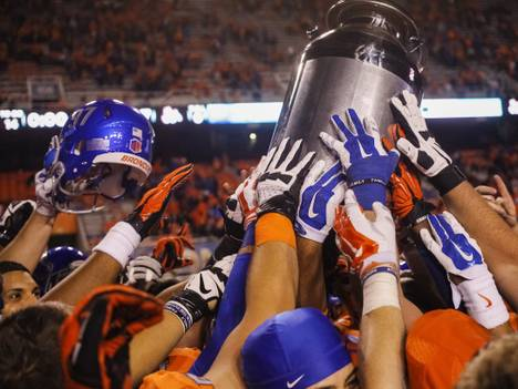 Boise State players hold the Milk Can trophy after defeating Fresno State 37-27 in Boise, Idaho, on Friday, Oct. 17, 2014. The Milk Can trophy has been awarded to the winner of the Fresno State-Boise State game since 2005.