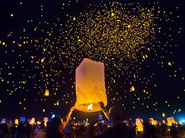 Participants inflate more lanterns and release them to the already speckled sky during the Rise Lantern Festival at Jean Dry Lake Bed on Saturday, Oct. 18, 2014, in Jean.