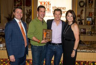 Celebrity chef Bobby Flay visits Three Square food bank Tuesday, Oct. 14, 2014, in Las Vegas.