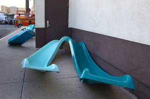Water slides are shown by the side of the Western Hotel in downtown Las Vegas Wednesday, Oct. 22, 2014. The slides will be part of an art installation by Eric Tillinghast during the Life is Beautiful festival.
