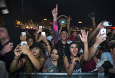 A crowd takes in a performance of The Weeknd at the Downtown Stage on the opening day of the Life is Beautiful Festival, Friday, Oct. 24, 2014.