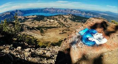 This undated photo taken from an Instagram posting shows an overlook of Crater Lake in Oregon with a rock painting. The National Park Service is investigating paintings and drawings of eerie faces found on rocks across the West in some of the country's most recognizable wilderness areas, including Crater Lake.