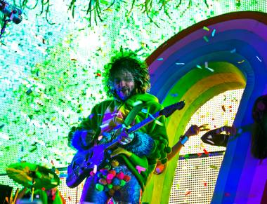 Mark Coyne of The Flaming Lips entertains an energetic crowd as they perform on the Ambassador Stage during day 2 of the Life is Beautiful Festival on Friday, October 24, 2014.