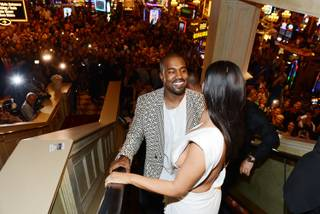 Kim Kardashian West, with husband Kanye West, makes her way to celebrate her 34th birthday at Tao on Friday, Oct. 24, 2014, in the Venetian.