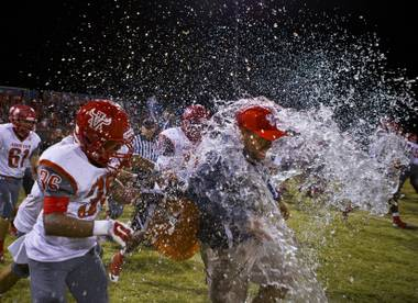 Arbor View celebrates after a win against Centennial, Oct. 30, 2014.