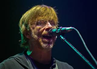 Trey Anastasio of Phish sings during the band's concert at MGM Grand Garden Arena on Halloween night on Friday, Oct. 31, 2014.