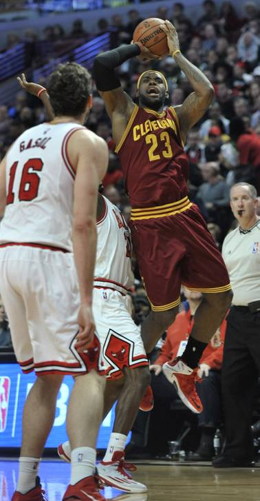Cleveland Cavaliers' LeBron James goes up for a shot during the first half of an NBA basketball game against Chicago Bulls in Chicago, Friday, Oct. 31, 2014. Cleveland won 114-108 in overtime.