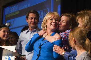 Congressional candidate Erin Bilbray gets a hug from her sister Shannon Bilbray-Axelrod after a concession speech during an election-night party for Democrats at MGM Grand on Tuesday, Nov. 4, 2014. Her husband Dr. Noah Kohn is at left. Bilbray was challenging Republican Congressman Joe Heck.