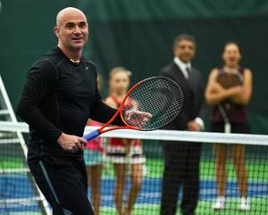 Andre Agassi plays doubles for fans on hand at the grand opening of Life Time Athletic on Thursday, Nov. 6, 2014, in Green Valley.