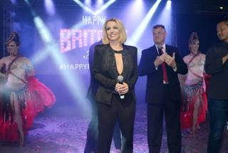 "Britney Spears, with Planet Hollywood, Bally's Las Vegas and Paris Las Vegas Regional President David Hoenemeyer, celebrates ""Britney Day"" at the Linq Promenade on Wednesday, Nov. 5, 2014, in Las Vegas."