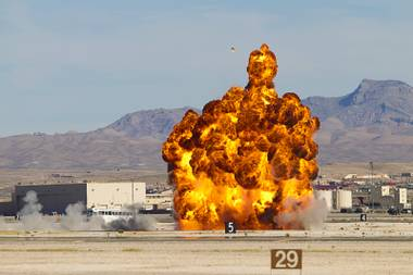 A explosion goes off during a mock bombing run at the 2014 Aviation Nation open house in Nellis Air Force Base Sunday, Nov. 9, 2014.