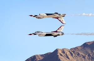 The U.S. Air Force Thunderbirds perform a Calypso Pass maneuver during the 2014 Aviation Nation open house at Nellis Air Force Base Sunday, Nov. 9, 2014.