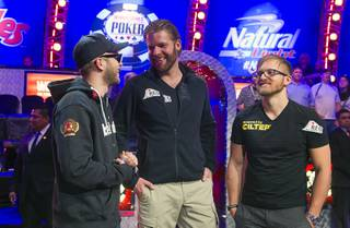 Finalists Felix Stephensen, 24, of Norway, Jorryt Van Hoof, 31, of the Netherlands and Martin Jacobson, 27, of Sweden gather after the first night of play during the 2014 World Series of Poker Main Event Final Table early Tuesday, Nov. 11, 2014, at the Rio. Play continues Tuesday night.
