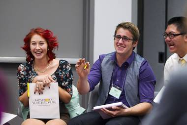 Miranda McGeahy of Southern Nevada High School, and Aaron Palmer of Sierra Vista, laugh during a discussion of marijuana legalization at the 58th annual Las Vegas Sun Youth Forum in the Las Vegas Convention Center Thursday, Nov. 13, 2014.
