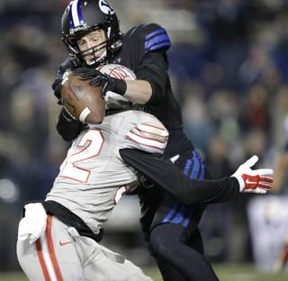Brigham Young wide receiver Mitch Mathews, rear, catches a pass over the back of UNLV defensive back Mike Horsey (32) in the second quarter during an NCAA college football game Saturday, Nov. 15, 2014, in Provo, Utah. (AP Photo/Rick Bowmer)