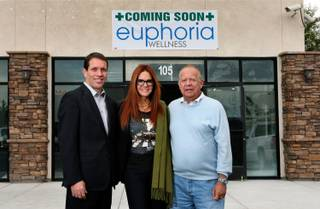 Spokesman Jim Ferrence, owner Deanne Lamb and owner Joe Lamarca of Euphoria Wellness, soon to be a medical marijuana dispensary. They hosted an open house Wednesday, Nov. 19, 2014.