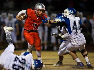 Liberty High School QB Kenyon Oblad  #7 fights through the Basic defense on Friday, November 21, 2014.