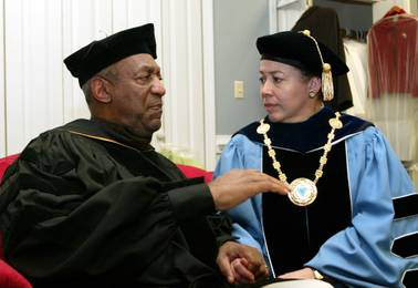 In this May 14, 2006, file photo, keynote speaker Bill Cosby and Spelman College President Dr. Beverly Tatum talk before the start of commencement at the school in Atlanta.