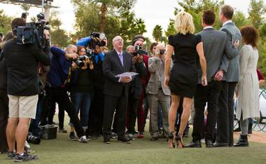 "Paul Devido presides over the wedding of Dan Mathews and Jack Ryan with Pamela Anderson and Chrissie Hynde at the ""Welcome to Fabulous Las Vegas"" Sign on Thursday, November 27, 2014."