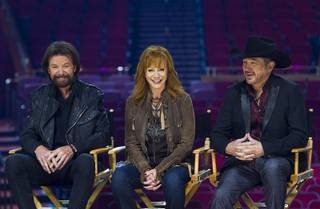 Ronnie Dunn, Reba McEntire and Kix Brooks respond to questions during a news conference in the Colosseum on Wednesday, Dec. 3, 2014, at Caesars Palace. The new residency