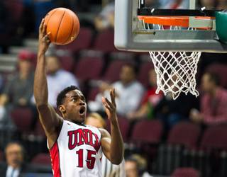 UNLV's Dwayne Morgan (15) gets high up for a short shot over the St. Katherine defense during their game at the Orleans Arena on Friday, December 5, 2014.
