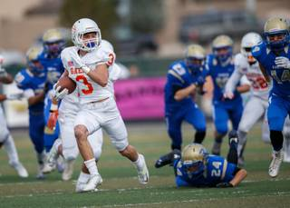 Bishop Gorman Brandon Gahagan (3) returns the opening kickoff deep into Reed territory during the NIAA State Championship Football game between the Bishop Gorman Gaels and the Reed Raiders at Damonte Ranch High School in Reno, Nevada.