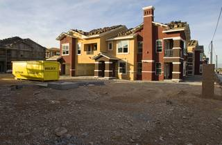Construction continues on the Somerset Hills Apartments, 10695 S. Dean Martin Drive, Sunday, Dec. 7, 2014.