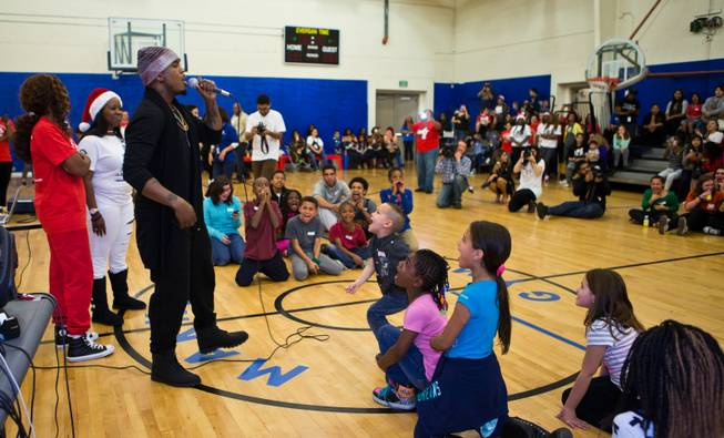 Singer Ne-Yo joins the Boys & Girls Clubs of Southern Nevada to meet the kids and help deliver 500 presents at the John Kish Boys & Girls Club on Wednesday, Dec. 10, 2014.