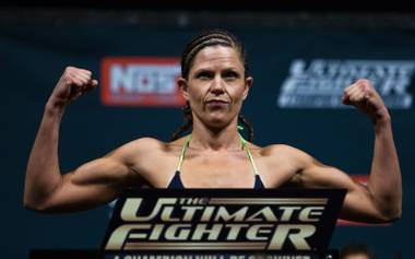 Strawweight fighter Emily Peters Kagan flexes while weighing in for the Ultimate Fighter reality show finale live from the Pearl at the Palms Casino on Thursday, December 11, 2014.