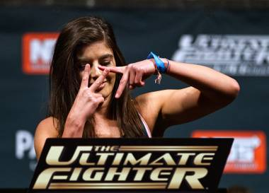 Strawweight fighter Alex Chambers throws a symbol to the fans while weighing in for the Ultimate Fighter reality show finale live from the Pearl at the Palms Casino on Thursday, December 11, 2014.