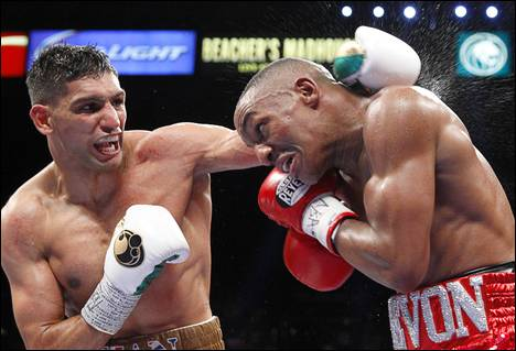 Amir Khan, left, of Britain battles with Devon Alexander of St. Louis, Mo. during a welterweight fight at the MGM Grand Garden Arena Saturday, Dec. 13, 2014.