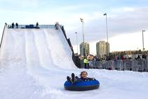 Ariel Ouellette, 10, of Las Vegas rides on the the Winter Parq tubing hill in the Linq parking lot Sunday, Dec. 14, 2014. The Winter Parq hill is open Monday through Friday from 4 to 10 p.m. and Saturday through Sunday from 2 to 10 p.m. The hill will close at 8:30 p.m. Christmas Eve.