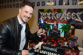 "Mark Shunock celebrates the second anniversary of ""Rock of Ages"" on Thursday, Dec. 18, 2014, in the Venetian."
