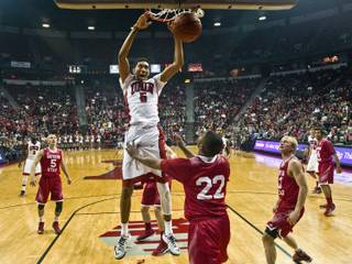 UNLV forward Christian Wood (5) dunk the ball over the Southern Utah defense during their game at the Thomas & Mack Center on Saturday, December 27, 2014.