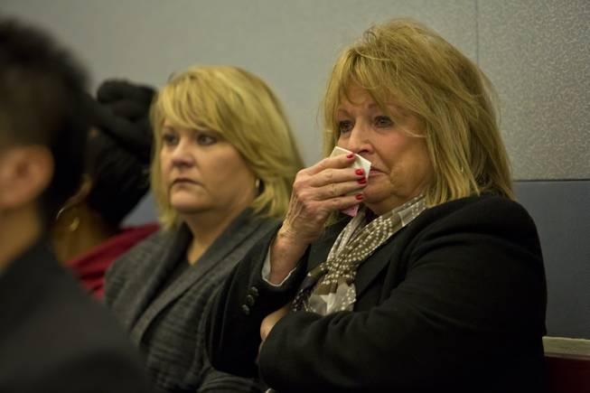 Family and friends of 63-year-old Michael Grubbs, who was killed on Nov 24 in a hit-and-run, tear up durring a preliminary hearing for the accused, 29-year-old Galina Stoyanova Kilova, Wed. Dec. 31, 2014.