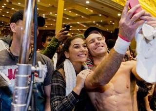 Donald Cerrone poses with fans during the open workout for UFC 182 Wednesday, December 31, 2014 at the MGM Grand in Las Vegas, Nev.