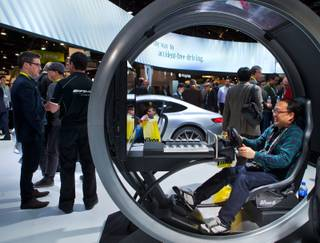The Mercedes display area features a driver's experience as well as new vehicles to explore during CES 2015 at the Las Vegas Convention Center on Tuesday, January 6, 2015.