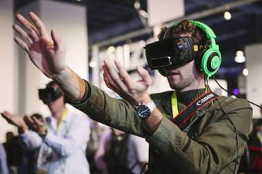 A consumer plays a video game using an OSVR (Open Source Virtual Reality) headset on display at CES 2015 in the Las Vegas Convention Center on Wednesday, January 7, 2015.
