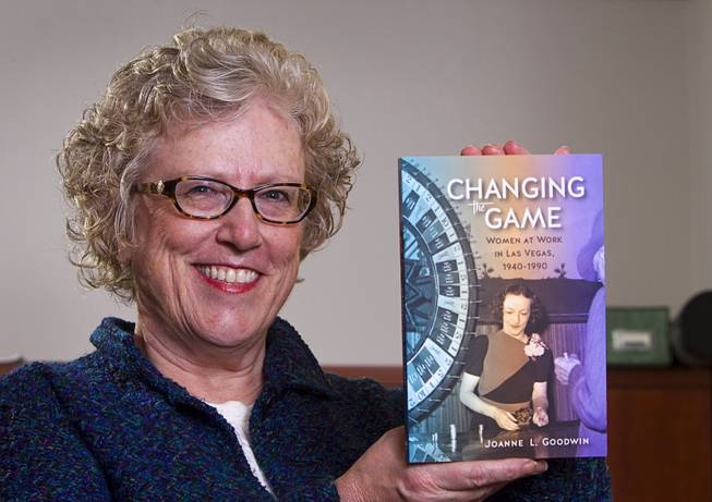 "Joanne Goodwin, a UNLV history professor and director of the Women's Research Institute, poses with her book ""Changing the Game: Women at Work in Las Vegas 1940-1990"" at UNLV Monday, Jan. 12, 2015."