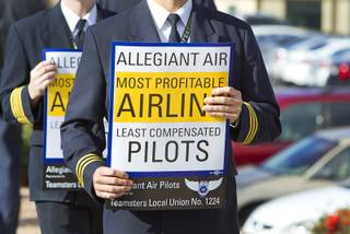 Allegiant Air pilots hold signs as they picket in front of the Allegiant Air headquarters in Summerlin Tuesday, Jan. 13, 2015. Pilots, represented by the International Brotherhood of Teamsters union, have been in contract negations with the company for two years, a union representative said.