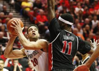 San Diego State forward J.J. O'Brien gets ready to shoot over UNLV forward Goodluck Okonoboh during the second half of an NCAA college basketball game won 53-47 by San Diego State Saturday, Jan. 17, 2015, in San Diego. (AP Photo/Lenny Ignelzi)