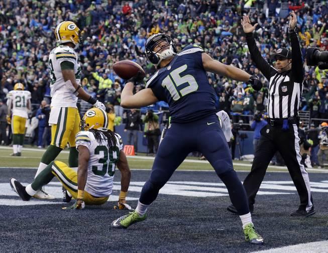 Seattle Seahawks' Jermaine Kearse celebrates after catching the game-winning touchdown during overtime of the NFC Championship game against the Green Bay Packers on Sunday, Jan. 18, 2015, in Seattle. The Seahawks won 28-22 to advance to Super Bowl XLIX.