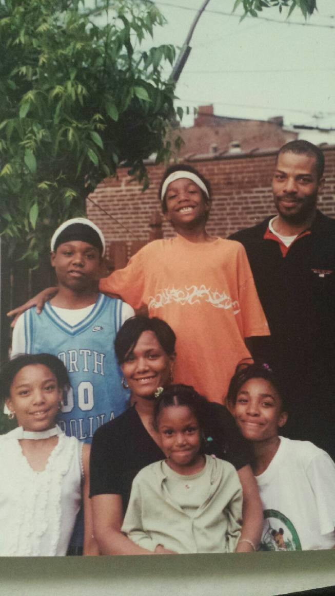 Pat McCaw (middle) was wearing a headband long before he arrived at UNLV, posing here with his parents Jeff Sr. and Teresa, and siblings (clockwise) Celeste, Camille, Jayla and Jeff Jr. Pat McCaw's youngest sister, Trinity, is not pictured.