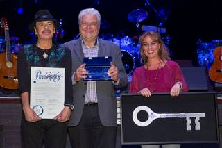 Carlos Santana, Clark County Commissioner Steve Sisolak and Roxana Drexel, director of the Hermes Music Foundation, during a ceremony at House of Blues on Wednesday, Jan. 21, 2015, in Mandalay Bay. Santana and Hermes Music U.S. were honored for their donation of 80 guitars to Monaco Middle School's music programs.