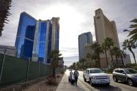 A view of the stalled Fontainebleau resort, left, on Las Vegas Boulevard South Wednesday, Jan. 22, 2015. Fontainebleau Las Vegas filed for bankruptcy protection in June 2009. Carl Icahn assumed part-ownership of the project in 2010.