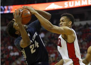 Utah State guard JoJo McGlaston (24) is shut down by UNLV guard Rashad Vaughn (1) during a game at the Thomas & Mack Center Saturday, Jan. 24, 2015.