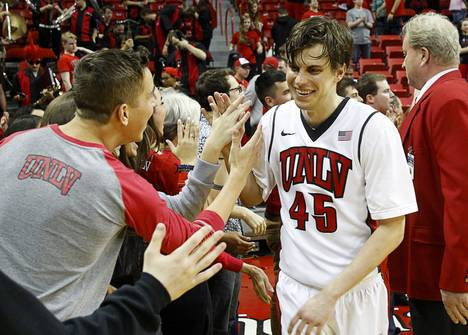 UNLV guard Cody Doolin (45) is congratulated by fans after UNLV beat Utah State in overtime at the Thomas & Mack Center on Saturday, Jan. 24, 2015. Doolin's two free throws put UNLV up 79-77.