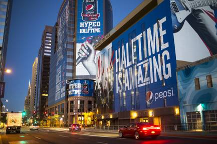 Ads for the Super Bowl are displayed in downtown Phoenix on Thursday, Jan. 22, 2015. The Super Bowl between the Seattle Seahawks and the New England Patriots is to be played Feb. 1, 2015, in Glendale, Ariz.